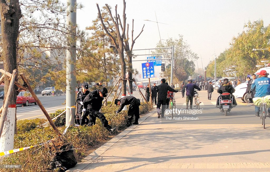 Police officers investigate near an office building belonging to the Chinese Communist Party's provincial committee on November 7, 2013 in Taiyuan, Shanxi province, China. The bomb blasted on November 6, at least one killed, eight injured according to the local reports.