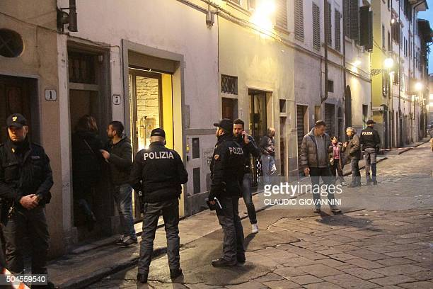 Police officers investigate on January 9 2016 outside the building that houses the flat of Ashley Olsen a 35yearold American expatriate artist who...