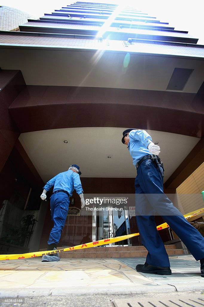Police officers investigate the apartment where a 15-year-old girl killed her classmate on July 27, 2014 in Sasebo, Nagasaki, Japan. According to the Nagasaki prefectural police, the student repeatedly struck the back of Aiwa Matsuo's head with a hand tool and strangled her with a rope in her apartment between 8 p.m. to 10 p.m. on July 26. Police confirmed the cause of death to be suffocation by cervical compression.