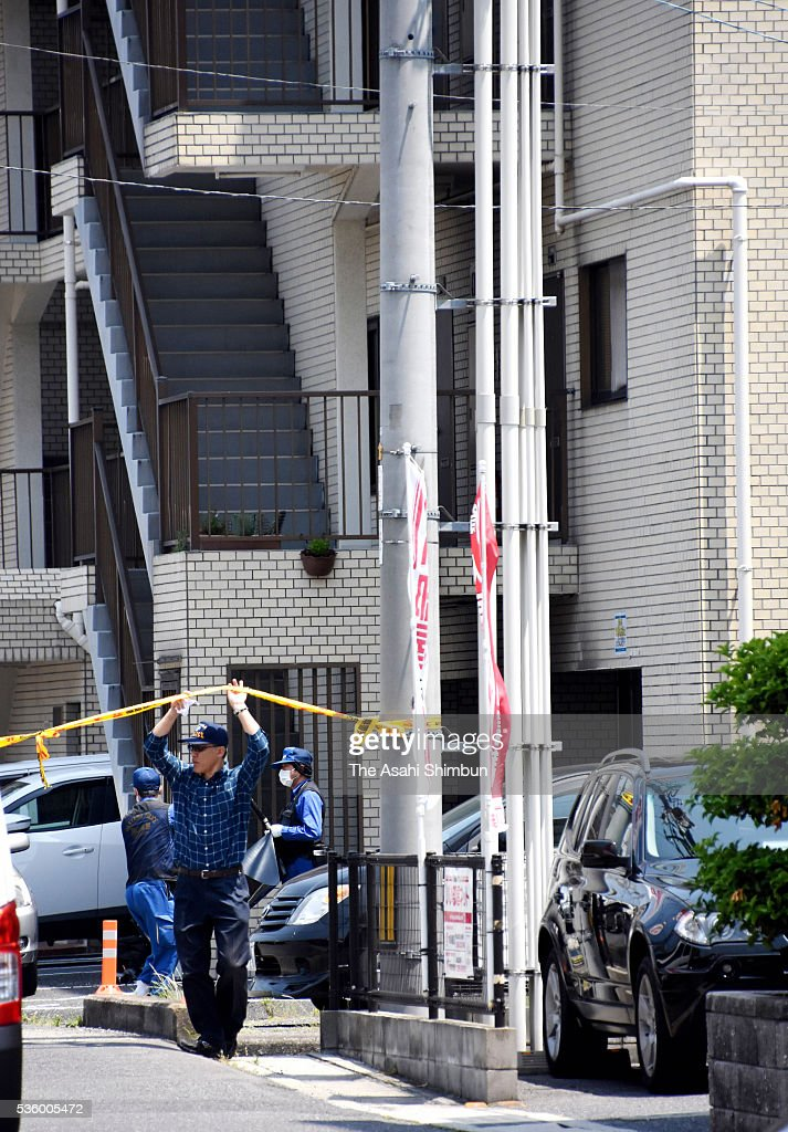 Police officers investigate the parking lot of a condominium where Tadashi Takagi, 55, was found shot several times in the chest and stomach on May 31, 2016 in Okayama, Japan. Takagi is the second-in-command of the Ikeda-gumi organized crime syndicate, which is affiliated with the Kobe Yamaguchi-gumi. The Kobe Yamaguchi-gumi broke away from Japan's largest yakuza organization Yamaguchi-gumi at the end of August 2015.