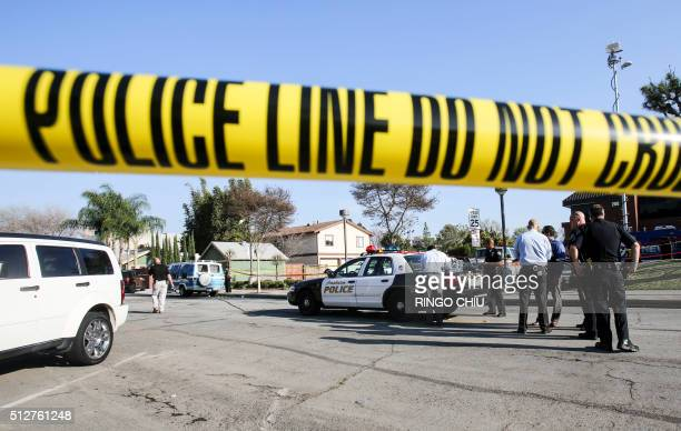 Police officers investigate the scene near Pearson Park in Anaheim California February 27 after three counterprotesters were stabbed while clashing...
