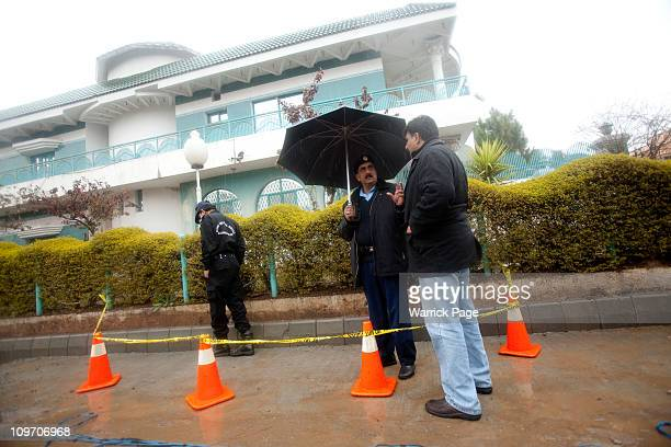 Police officers investigate the site of Pakistan Minority Minister Shahbaz Bhatti's assassination near his mother's home on March 2 2011 in Islamabad...