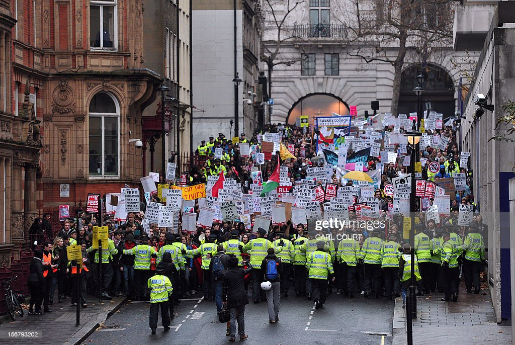 Police officers keep control during a student rally in central London on November 21, 2012 against sharp rises in university tuition fees, funding cuts and high youth unemployment.