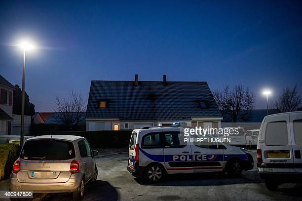Police officers keep guard during investigations at a house in Sainte Catherine les Arras on January 1 after an incident which left four people dead...
