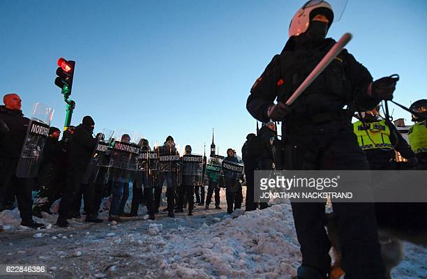 Police officers keep the neonazi Nordic Resistance Movement sympathisers demonstrators away from the counterprotesters in central Stockholm on...