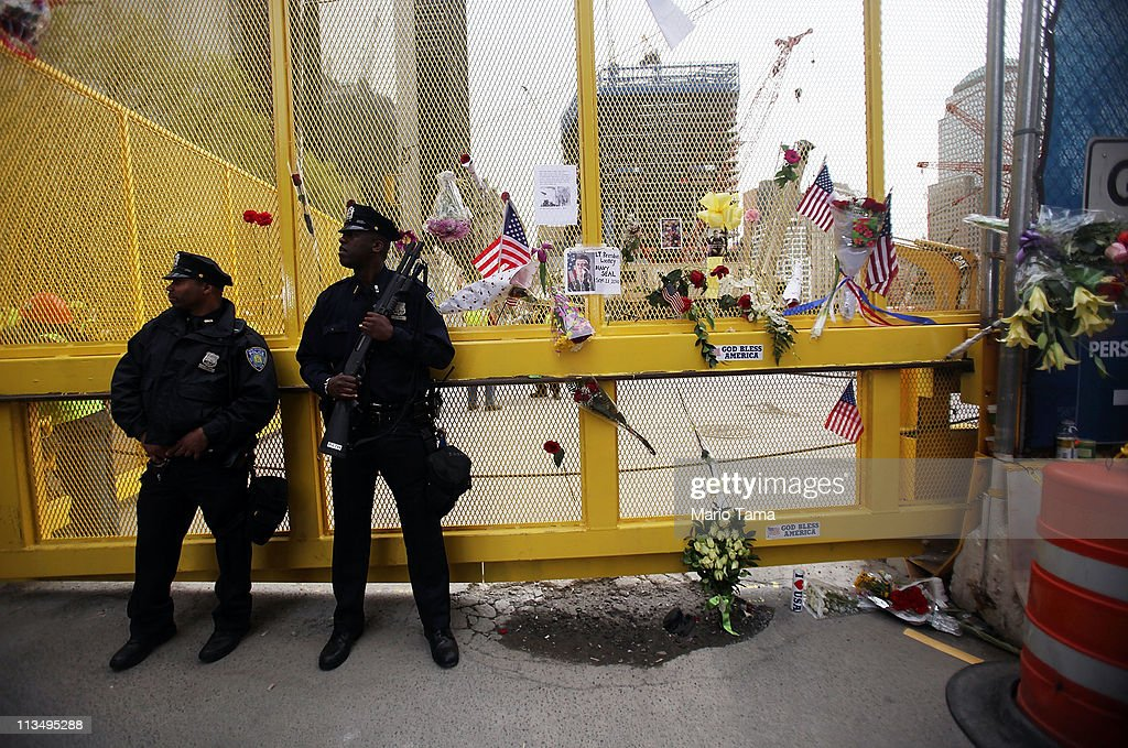 Police officers keep watch at a makeshift memorial on the fence surrounding the World Trade Center site after the death of accused 9/11 mastermind Osama bin Laden was announced May 2, 2011 in New York City. Bin Laden was killed in an operation by U.S. Navy Seals in a compound in Abbottabad, Pakistan.