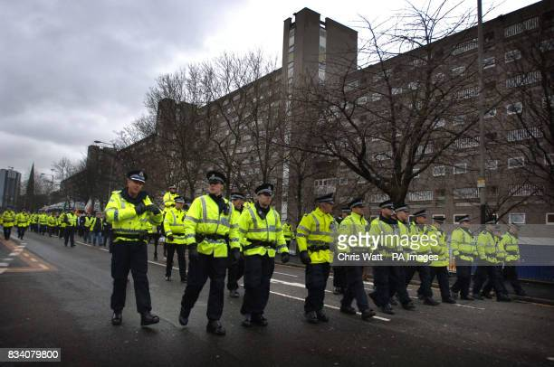 Police officers lead a parade to remember the victims of Bloody Sunday in Glasgow this morning
