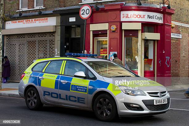 Police officers leave in a car the constituency office of British Labour Party member of parliament Neil Coyle in London on December 4 after the...