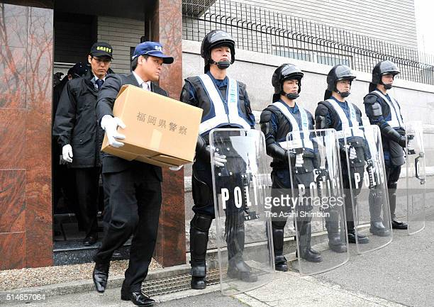 Police officers leave the head office of Kobe Yamaguchigumi with boxes of evidences after investigating a case involving a suspected attack on a...