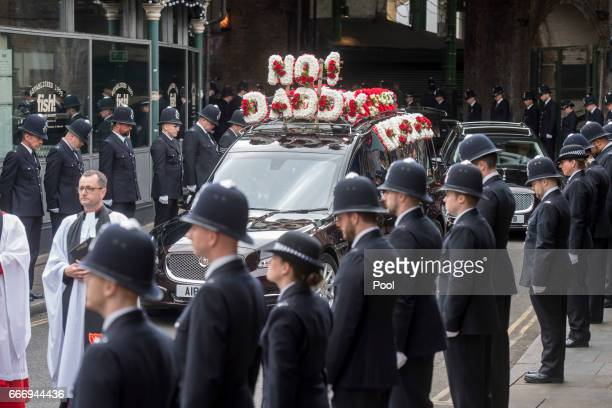 Police officers line the route in Southwark as the funeral procession of PC Keith Palmer makes its way to Southwark Cathedral on April 10 2017 in...