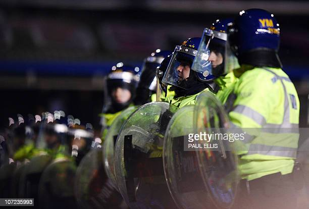 Police officers line up to hold back Birmingham City fans after the English Football League Cup football match betwen Birmingham City and Aston Villa...