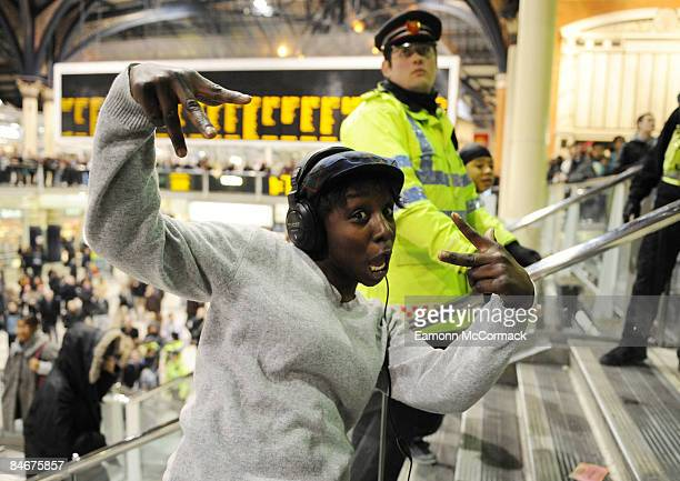 Police officers look on as a crowd of flashmob dancers congregates at London Liverpool Street Station on February 06 2009 in London England