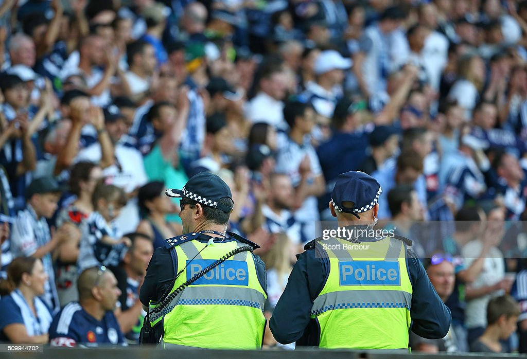 Police officers look on as Melbourne Victory fans in the crowd watch the match during the round 19 A-League match between Melbourne City FC and Melbourne Victory at AAMI Park on February 13, 2016 in Melbourne, Australia.