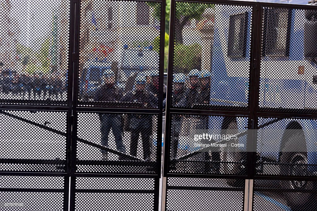 Police officers look on as over a thousand demonstrators march in protest against the recent EU migrant agreements made between the Turkish government and the European Union and in support of 'No Borders' and freedom of human movement near the Turkish embassy on May 1, 2016 in Rome, Italy. Police closed roads around the embassy as protestors donned life jackets and created camps of tents surrounded by barbed wire.