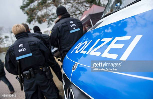 Police officers look on prior the Bundesliga match between Eintracht Frankfurt and Bayer 04 Leverkusen at CommerzbankArena on November 21 2015 in...
