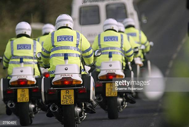 Police Officers make their way to Prime Minister Tony Blair's home before the arrival of US President George W Bush on November 21 2003 in Sedgefield...