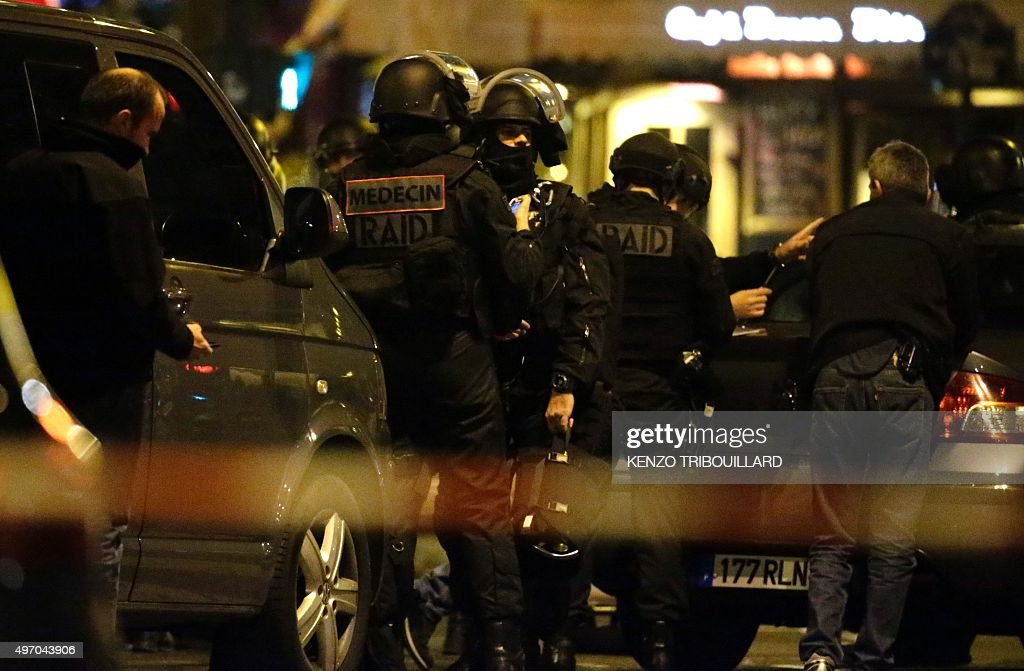 Police officers man a position close to the Cafe Bonne Biere on November 13 2015 after a series of gun attacks occurred across Paris as well as...