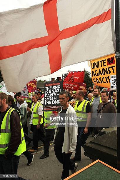 Police officers marshall antBNP protesters near British National Party's annual Red White and Blue Festival at Codnor on August 16 2008 near Ripley...