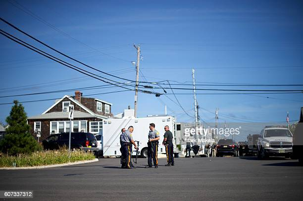 Police officers monitor activity near the scene of an 'pipe bombstyle device' explosion on September 17 2016 in Seaside Park New Jersey The explosive...