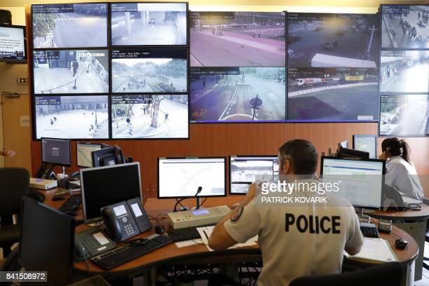Police officers monitor control screens in the command room of security of proximity of the Paris Police Prefecture on September 1 2017 in Paris /...