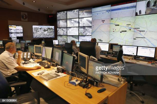 Police officers monitor control screens in the command room of public order and traffic at the Paris Police Prefecture on September 1 2017 in Paris /...