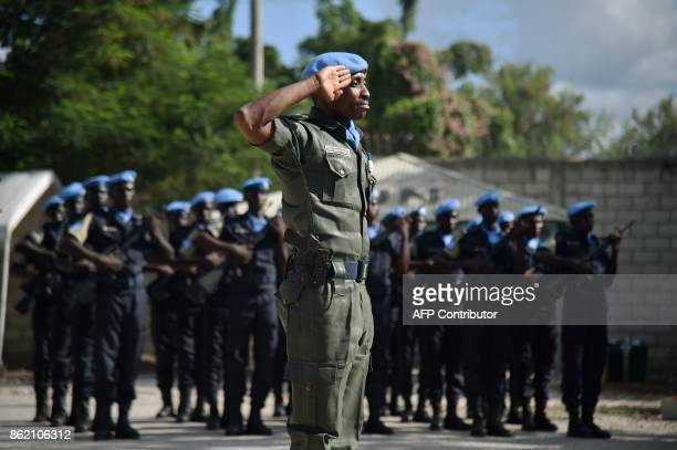 Police officers of the UN Formed Police Unit attend the opening ceremony of the United Nations Mission for Justice Support in Haiti held at Delta...