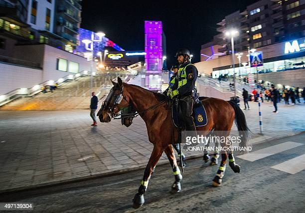 Police officers on horses patrol ahead of the Euro 2016 playoff football match between Sweden and Denmark at the Friends arena in Solna on November...