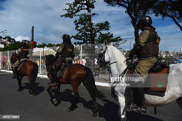 Police officers on horses patrol the arena before the 2014 FIFA World Cup Brazil Group B match between Spain and Netherlands at Arena Fonte Nova on...