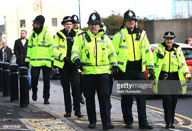 Police officers on patrol outside St James' Park ahead of the Barclays Premier League match between Newcastle United FC and Leicester City FC at St...