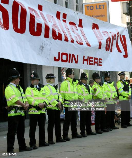 Police officers on standby as antiwar protesters take to the streets in the city centre of Manchester ahead of the Labour Party's annual conference