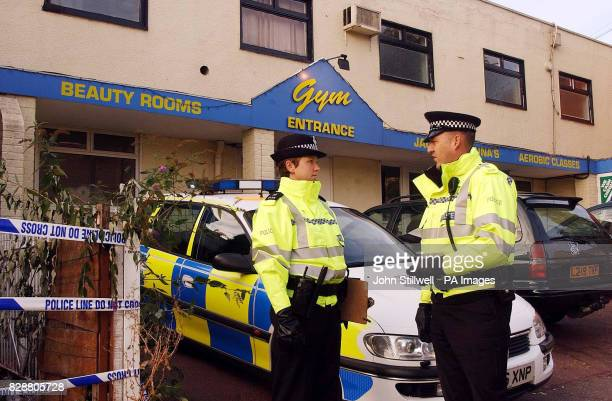 Police Officers outside the front door of the Physical Limit Gym and fitness centre in the town centre of Hoddesdon Hertfordshire following...