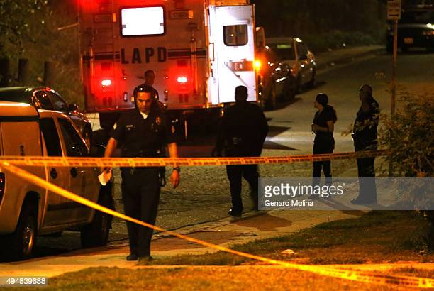 LOS ANGELES CA OCTOBER 28 2015 Police officers oversee the crime scene where the bodies of two females were discovered at the south edge of Ernest E...