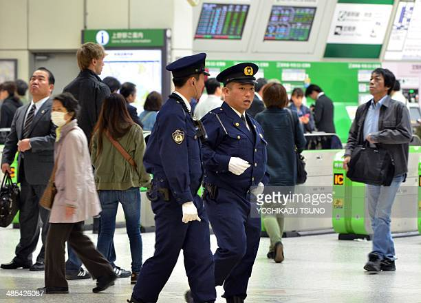 Police officers patrol a train station in Tokyo on April 18 2014 ahead of the upcoming visit of US President Barack Obama The US leader will come to...