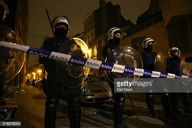 Police officers patrol after raids in which several people including Paris attacks suspect Salah Abdeslam were arrested on March 18 2016 in...