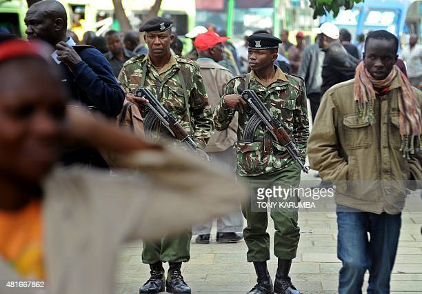 Police officers patrol along a street in the Kenyan capital Nairobi on July 23 2015 less than 48 hours ahead of the expected touchdown of the...
