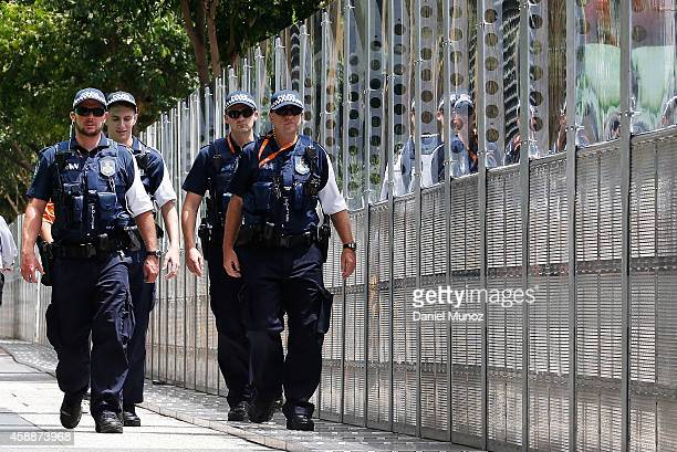 Police officers patrol around a fence near the Brisbane Convention and Exhibition Centre on November 13 2014 in Brisbane Australia World economic...