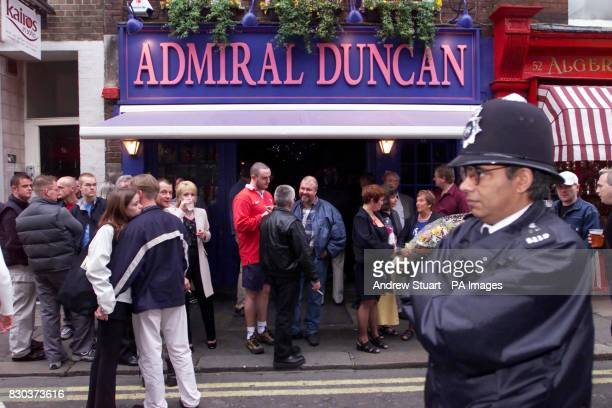 Police officers patrol at the Admiral Duncan Pub in Old Compton Street central London during the first anniversary of the Soho pub nail bomb attack...