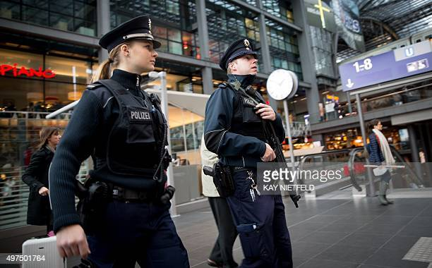 Police officers patrol at the main railway station in Berlin on November 17 2015 Security has been tightned in Germany following the string of...