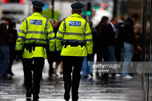 Police officers patrol Buchanan Street in Glasgow December 7 2007 in ScotlandThere is growing anger as Scotland's police officers will receive a...
