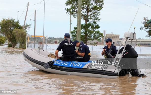 ROCKHAMPTON QLD Police officers patrol by boat through floodwaters at Depot Hill in Rockhampton Queensland after the Fitzroy River burst its banks in...
