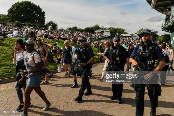 Police officers patrol by the Murray Mound on day two of the Wimbledon Lawn Tennis Championships at the All England Lawn Tennis and Croquet Clubon...