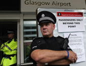 Police officers patrol Glasgow Airport terminal August 10 2006 in Glasgow Scotland British Airports have been thrown into chaos as Airport security...