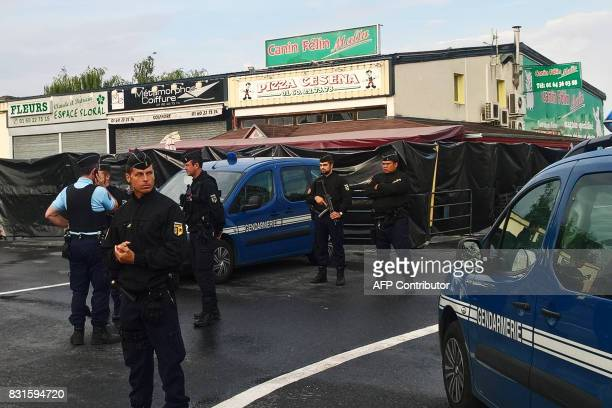 Police officers patrol in front of the scene of a car crash into a pizza restaurant on August 15 2017 in SeptSorts 55km east of Paris resulting in...
