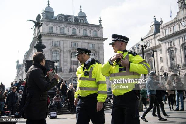 Police officers patrol in Piccadilly Circus on March 24 2017 in London England A fourth person has died after Khalid Masood drove a car into...
