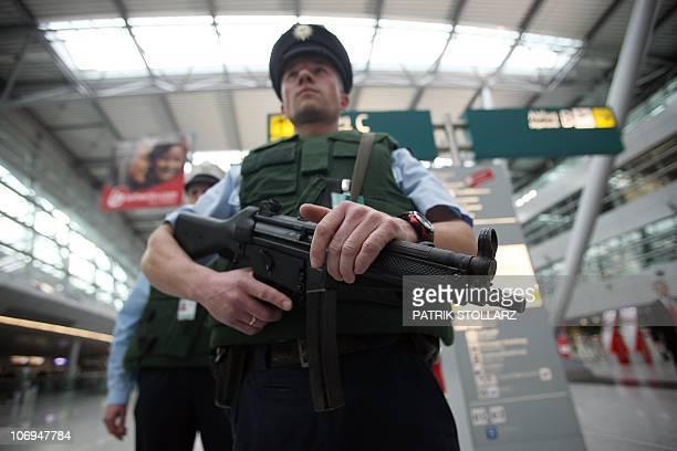 Police officers patrol in the departure hall of Duesseldorf International Airport on November 18 2010 in Duesseldorf western Germany Germany's...