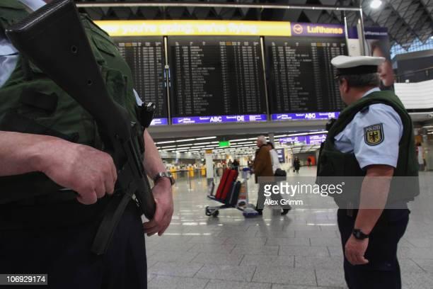 Police officers patrol in the departure hall of Frankfurt International Airport on November 17 2010 in Frankfurt am Main Germany Germany's interior...
