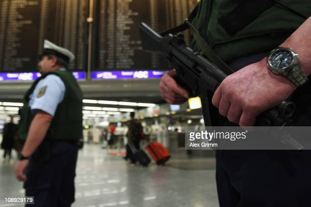 Police officers patrol in the departure hall of Frankfurt International Airport on November 17 2010 in Frankfurt am Main Germany Germany's interior...