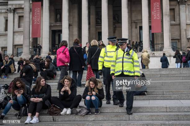 Police officers patrol in Trafalgar Square on March 24 2017 in London England A fourth person has died after Khalid Masood drove a car into...