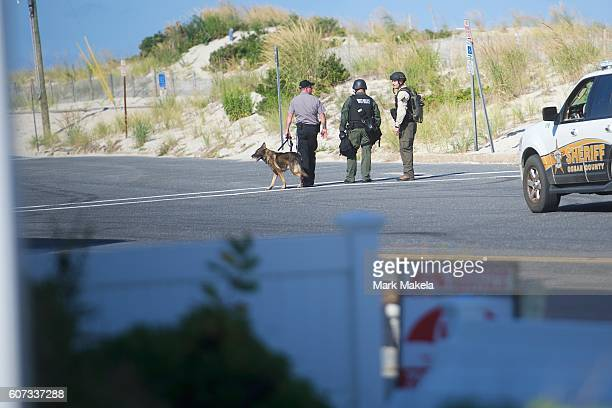 Police officers patrol near the scene of an 'pipe bombstyle device' explosion on September 17 2016 in Seaside Park New Jersey The explosive device...