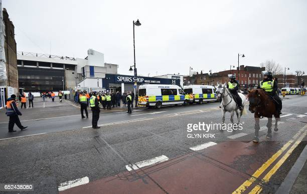 Police officers patrol on horses as fans arrive at the stadium ahead of the English FA Cup quarterfinal football match between Tottenham Hotspur and...